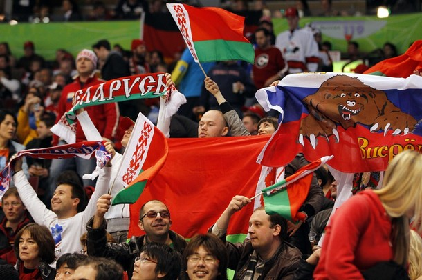 Fans of Belarus hockey team cheer on their team after goal against Germany in their men's preliminary round ice hockey game at Vancouver 2010 Winter Olympics